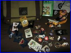 Collectible Mickey Mouse Disneyland pin lot with collectors travel bag